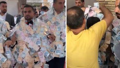 """صورة لن تصدق.. كمية المال التي تم تعليقها في عنق هذا العريس في ليلة زفافه """"فيديو"""""""